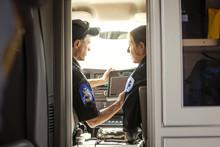 Female And Male Paramedics In Ambulance