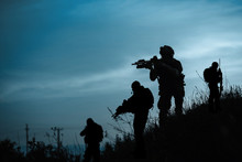 Silhouette Of Military Soldier Or Officer With Weapons At Night. Shot, Holding Gun