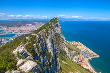 Aerial View Of Top Of Gibraltar Rock, In Upper Rock Natural Reserve: On The Left Gibraltar Town And Bay, La Linea Town In Spain At The Far End, Mediterranean Sea On The Right. United Kingdom, Europe.