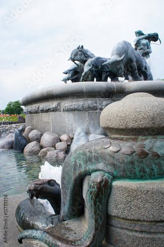 Photo  Fragment of fountain Gefion in Copenhagen, Denmark view to snake