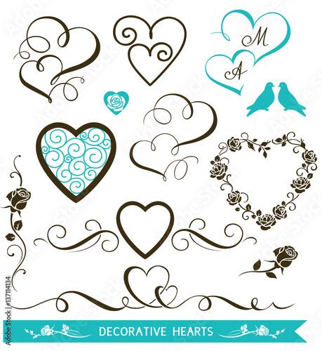 Carta da parati Set of decorative calligraphic hearts for wedding design