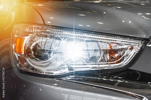 Obraz Closeup on an headlight of a sport car - fototapety do salonu