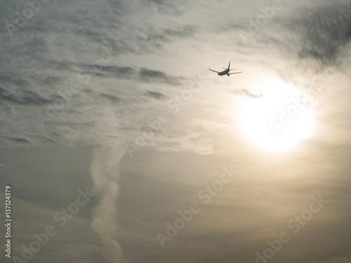 Fotografie, Obraz  Aircraft flying towards sun