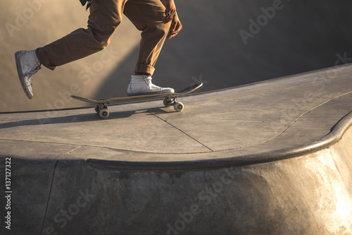 Legs and feet of male skateboarder in park, Venice Beach, California, United States of America