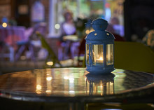 Metal Table Top Lantern At Night Outside A Cafe