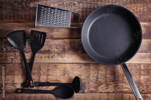 Fotografie, Obraz  Kitchen tools with pan on wooden background