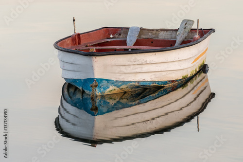 wooden fishing boat on a background of water Fototapet