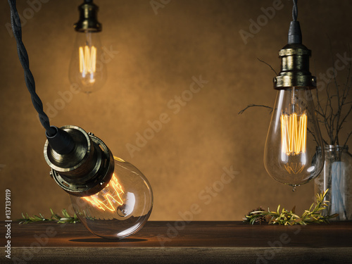 Photo  Three glowing vintage bulbs and empty table. 3d rendering