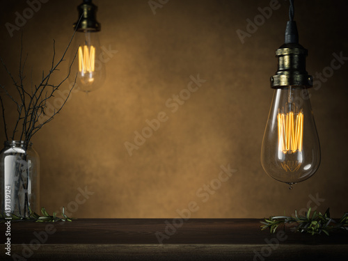 Two glowing vintage bulbs and empty table . 3d rendering Canvas Print