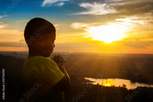 Boy praying on the Mount, thank God.