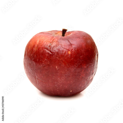 Valokuva  Red rotten apple isolated, natural color and texture