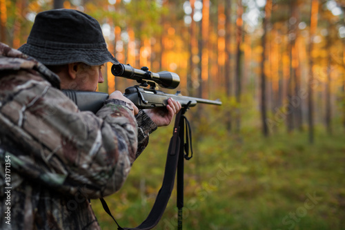 Aluminium Prints Hunting Hunter aiming with rifle