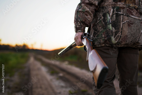 Foto op Canvas Jacht Hunter with rifle