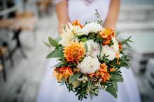 Elegant Orange And White Wedding Bouquet At Hands Of Bride.