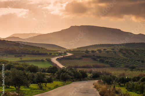 Fotomural scenic view of cretan landscape at sunset