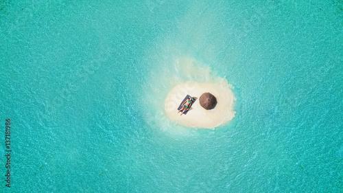 Fotografie, Obraz  Young woman sunbathing on tiny sandy island
