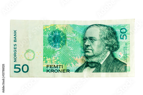 Fotografía  Close-ups of 50 NOK Norwegian crones paper bank notes isolated over white background