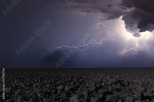 Thunderstorm with lightning in plowed field Canvas-taulu