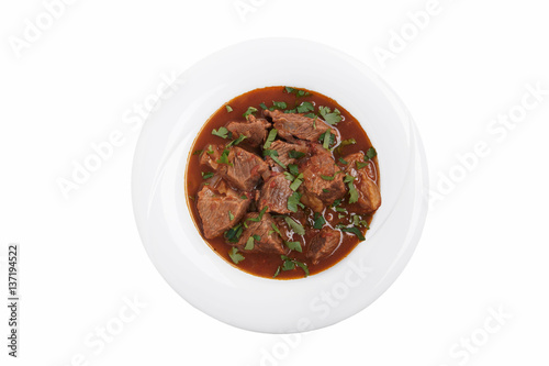 Fotografie, Obraz  beef stew in tomato sauce traditional Georgian dish chashushuli white background