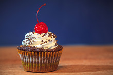Cupcake With Red Cherry On Top