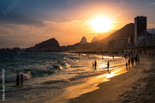 In de dag Rio de Janeiro Sunset View in Copacabana Beach with Mountains in Horizon and Tall Hotel Building, Rio de Janeiro