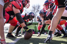 American Football Players On The Line Of Scrimmage During A Match