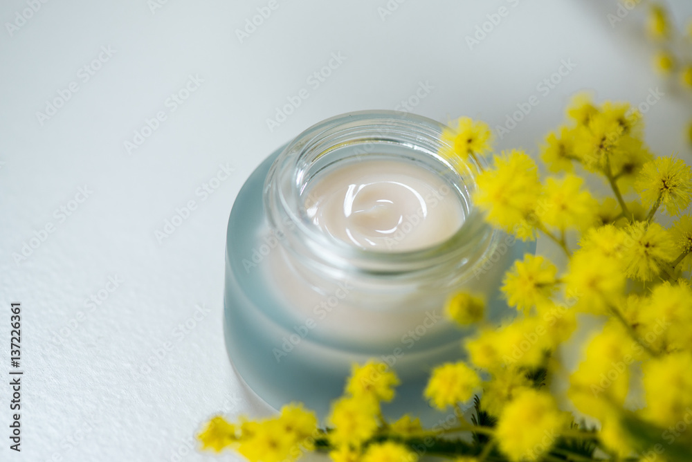 Fotografie, Obraz  Face cream and mimosa flower, white background