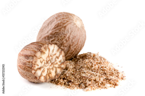 Fotografía  two nutmeg and powder isolated on white background