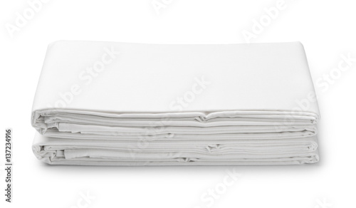 Fotografía  Stack of white folded bedding sheets