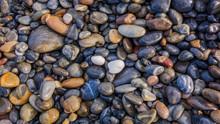 Wet Pebbles On The Seashore.  Background