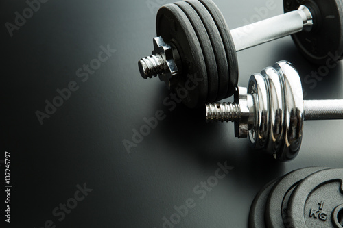 Fototapeta The metal dumbbell and weights. obraz