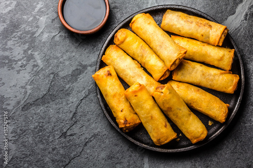 Fried spring rolls on iron plate. Top view