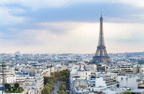Evening Eiffel tower and Paris city view form Triumph Arc. Eiffel Tower from Champ de Mars, Paris, France. Beautiful Romantic background.