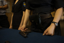 Hands And Gun Police Woman