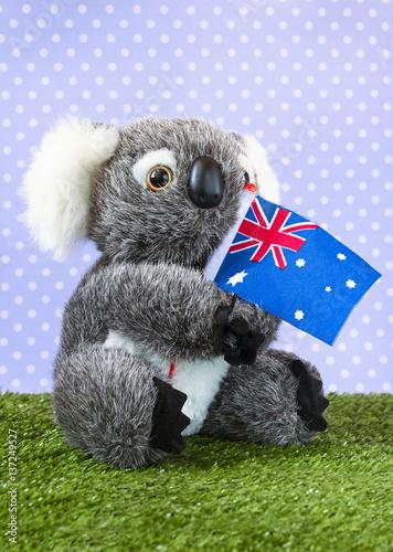 A very cute stuffed toy koala with an Australian flag.