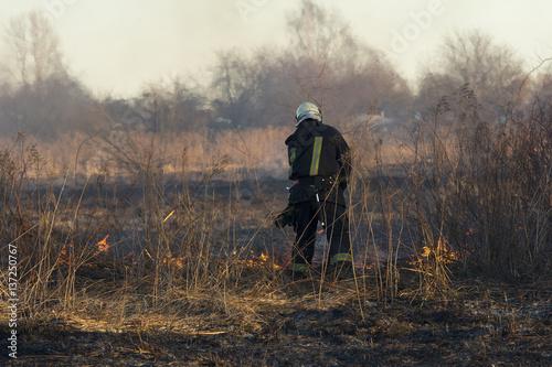 Foto op Canvas Jacht firefighters battle a wildfire