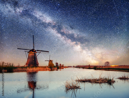 Fotografie, Obraz  Dutch mill at night. Starry sky. Holland. Netherlands