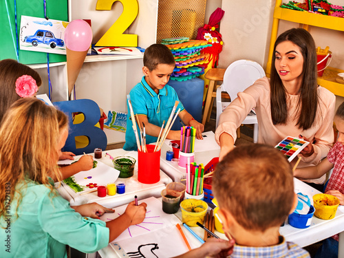 Children Painting And Drawing In Kids Club Craft Lesson Primary School Kindergarten Teacher Who Smiling
