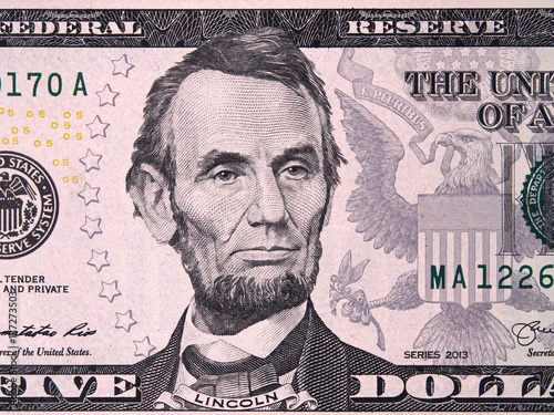 Foto  Abraham Abe Lincoln on USA five dollar bill close up, 5 usd, United States of Am