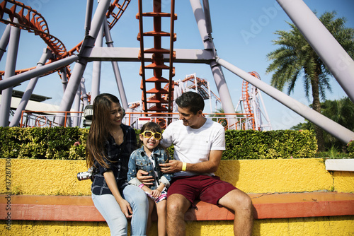 Foto auf Leinwand Vergnugungspark Family Holiday Vacation Amusement Park Togetherness