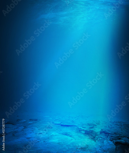 Fotobehang Koraalriffen Deep blue sea background with sunlight shining