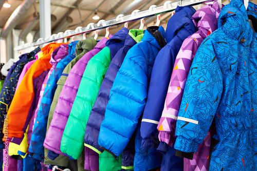Obraz na plátně Winter children sports jacket on hanger in store
