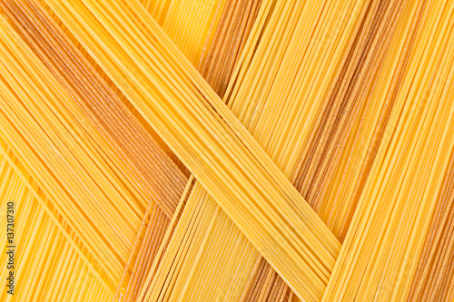 Fotografie, Obraz  Italian long spaghetti top view abstract background of different colors