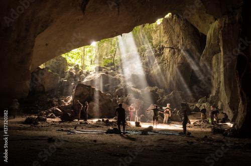 Tourists in rainforest cave in Taman Negara, Malaysia