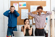 Colleagues closing mouth, eyes and ears with hands in office. See-hear-speak no evil variation.