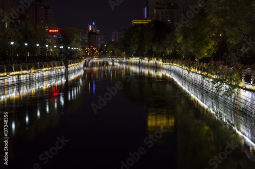 Poster Channel Illuminated canal in a city at night