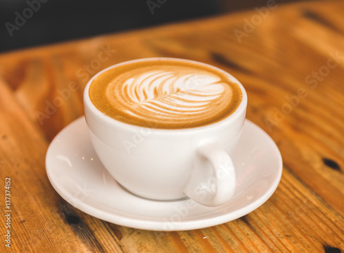 Fotografie, Obraz  Perfect cappuccino in white cup on wood table