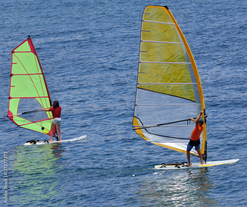 Two windsurfer the ocean - the coach and pupil