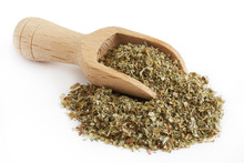 Pile Of Dried Marjoram Leaves With Wooden Scoop Isolated On White Background