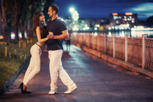 Young Couple Dancing Tango On The Embankment